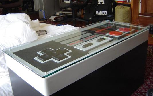 [ameu003dhttp://www.youtube.com/watch?vu003d2c3q9K4cHzY]YouTube   Giant NES  Controller Coffee Table[/ame]
