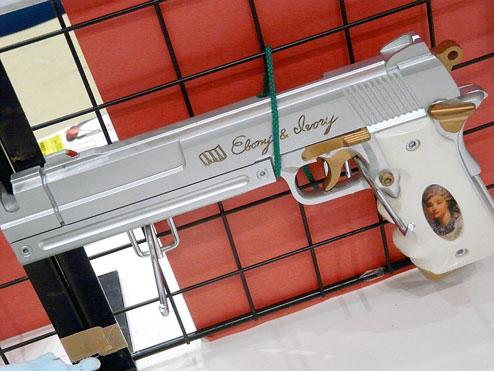 Dante's Ebony & Ivory handguns.