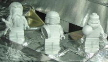 Three Aluminum LEGO Figurines on a Mission to Jupiter
