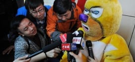 Furry: Lottery Winner Collects His Cash Wearing a Yellow Bear Costume