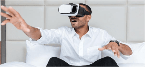 Man in a white shirt with virtual reality headset on